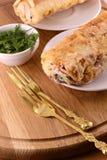 Burritosverpackungen mit Fleischbohnen und -gemüse Stockbild