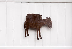 Burro Artwork. A rustic iron burro hanging on a wall in Santa Fe, New Mexico Stock Image