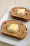 Burro del pane di uva passa della cannella Immagine Stock Libera da Diritti