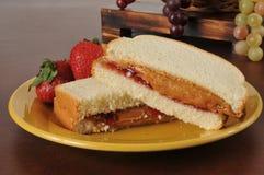 Burro di arachidi e panino alla marmellata Fotografia Stock