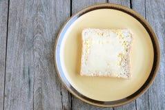 Burro e latte condensato del pane Fotografia Stock