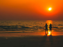 Burry In a dream frame man and woman sight seeing on the beach w Stock Image