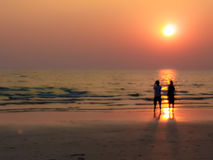 Burry In a dream frame man and woman sight seeing on the beach w Stock Photography