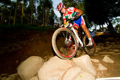 Burry Stander XCO rider over rock Stock Photo