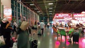 Travelers at Bursa Bus Terminal at night stock video footage