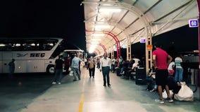 Passengers waiting the bus at Bursa Bus Terminal at night. Bursa, Turkey - August 15, 2018: Unidentified people waiting the bus at Bursa Bus Terminal at night stock video