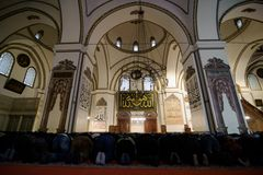 BURSA, TURKEY - JANUARY 26, 2015: People are praying in Grand Mosque Turkish Ulu Cami. The mosque is most important mosque in Burs royalty free stock image