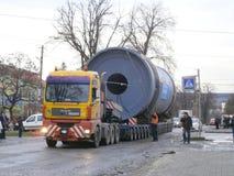 Oversized Cargo Transportation. Burshtyn, Ivano-Frankivsk region, Ukraine - 12 December 2017 : Trailer truck of the company `Ukrtransalliance` carries oversized Royalty Free Stock Images