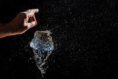 Burst of a balloon filled with water Stock Photos