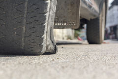 Burst car tire on street. Stock Images