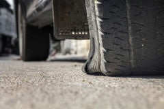 Burst car tire on street. Stopped ,burst car tire on street Royalty Free Stock Photos