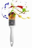 Burst of paint orbit around the paintbrush Royalty Free Stock Photos