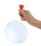 Burst my bubble! Concept - hope, optimism, love, life. Woman with dart. Popping that bubble. Business, commercial or personal life metaphor stock photos