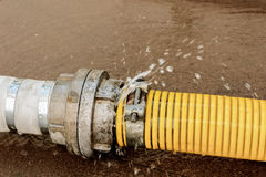 Burst pipe with water`s leak. Beat. Money loosing Royalty Free Stock Photography
