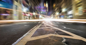 Burst Of Speed. Long exposure of lights from speeding vehicles passing by Stock Photos