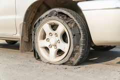 Burst tire car Royalty Free Stock Photo