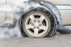 Burst tire on the road. Accident ,burst tire on the road stock image