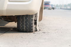Burst tire on the road Royalty Free Stock Images