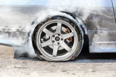 Burst tire on the road Royalty Free Stock Photos