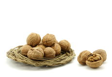 A burst of walnut and a plate of walnut Royalty Free Stock Image