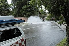 Burst Water Main. At traffic lights on main road royalty free stock images
