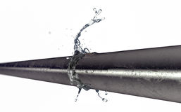 Bursted copper pipe with water leaking out Royalty Free Stock Photography