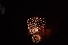 Bursting in air. Three simultainous spreys of fireworks Royalty Free Stock Image