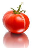 Bursting of the tomato on white Stock Photo