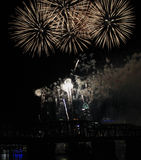 Bursting White Fireworks Over the Cincinnati Skyline Royalty Free Stock Photography