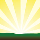 Bursting Yellow Sunrays. Bursting yellow sun rays blasting a landscape into a bright new day Stock Photo