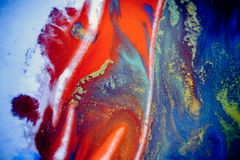 Bursts of multicolored paint. S and mixed together white paper. Drawn splashes of paints of different colors on white surface. Blue, yellow, red, green color Stock Photo