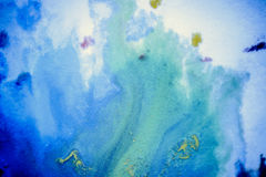 Bursts of multicolored paint. S and mixed together white paper. Drawn splashes of paints of different colors on white surface. Blue, yellow, red, green color Stock Image