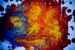 Bursts of multicolored paint. S and mixed together white paper. Drawn splashes of paints of different colors on white surface. Blue, yellow, red, green color Stock Photos