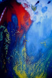 Bursts of multicolored paint. S and mixed together white paper. Drawn splashes of paints of different colors on white surface. Blue, yellow, red, green color Royalty Free Stock Photography