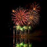 Bursts of Red, Orange and Green Fireworks Stock Photos