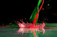 Bursts and splashes from falling paints of different colors.  royalty free stock photos