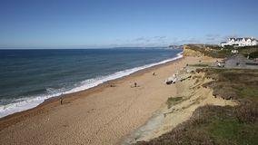 Burton Bradstock beach West Dorset England uk with people enjoying a beautiful day stock video