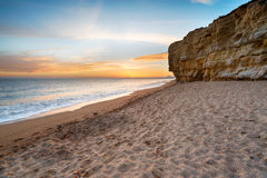 Burton Bradstock. Sunset over Hive Beach at cliffs at Burton Bradstock near Bridport on the Dorset coastline Stock Photo