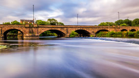 Burton Bridge. Captured from the side of the River Trent in Burton upon Trent, England Royalty Free Stock Photo