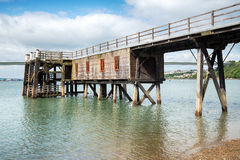 Burton Ferry Jetty. A wooden jetty on the banks of the Cleddau River at Burton Ferry in Pembrokeshire Stock Photo