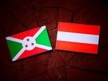 Burundi flag with Austrian flag on a tree stump  Stock Photo