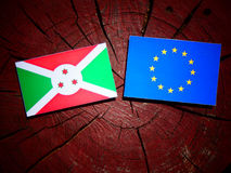 Burundi flag with EU flag on a tree stump isolated. Burundi flag with EU flag on a tree stump Stock Photography