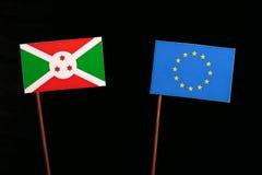 Burundi flag with European Union EU flag isolated on black. Background Royalty Free Stock Images