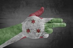 Burundi flag painted on male hand like a gun stock photo