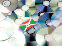Burundi flag on top of CD and DVD pile isolated on white Royalty Free Stock Images