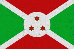 Burundi flagga på betongväggen arkivbild