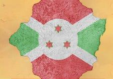 Burundi flaggaabstrakt begrepp i betong för agg för fasadstruktur stor skadad arkivbild
