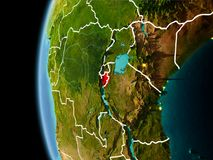 Burundi from space in evening. Evening over Burundi as seen from space on planet Earth with visible border lines and city lights. 3D illustration. Elements of Stock Photography