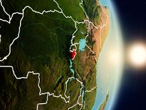 Burundi during sunrise. Highlighted in red on planet Earth with visible country borders. 3D illustration. Elements of this image furnished by NASA Royalty Free Stock Image