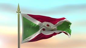 Burundiskt vinka för nationsflagga i vinden mot ultrarapiden för solnedgånghimmelbakgrund